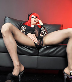 Zoe looking stunning with her new red hair and massive cock