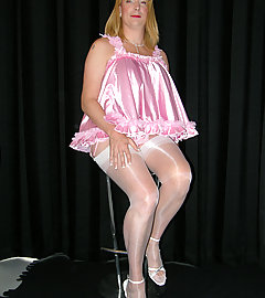 Cheeky crossdresser in pink teddy with guest Strapon Jane